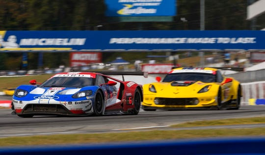 End of an era: The Ford GT, left, and front-engine Chevy Corvette raced at Road Atlanta for the last time Oct. 12.