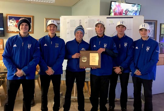 Horseheads golfers pose with their Section 4 Class A championship plaque after winning the tournament Oct. 17, 2019 at Soaring Eagles Golf Course in Horseheads.