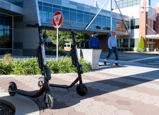 GOAT scooters are placed outside of the DoubleTree by Hilton hotel in Downtown Evansville, Ind., Thursday afternoon, Oct. 17, 2019.