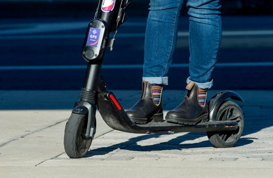 A GOAT scooter takes off in Downtown Evansville Thursday afternoon, Oct. 17, 2019.