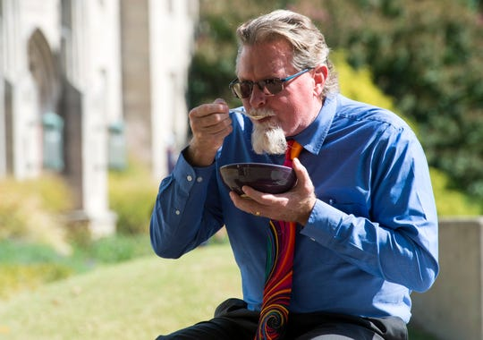 Carey Hudson enjoys his chili out of his recently purchased handmade bowl during UE's annual Clay Club Chili Bowl Sale Thursday afternoon, Oct. 17, 2019.