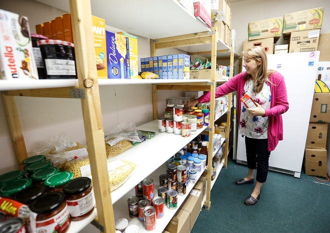 Food pantry coordinator Ronnell Gibson stocks a shelf Thursday, October 17, 2019 at the food pantry in Lighthouse Christian Church at 401 south National Ave in Fond du Lac, Wisconsin. Doug Raflik/USA TODAY NETWORK-Wisconsin