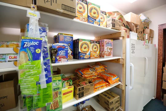 Stocked shelves of food Thursday, October 17, 2019 at the food pantry in Lighthouse Christian Church at 401 south National Ave in Fond du Lac, Wisconsin. Doug Raflik/USA TODAY NETWORK-Wisconsin