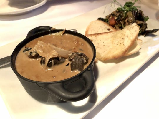 The escargot adobo ($12) remains a signature dish at A Table Apart in Bonita Springs.