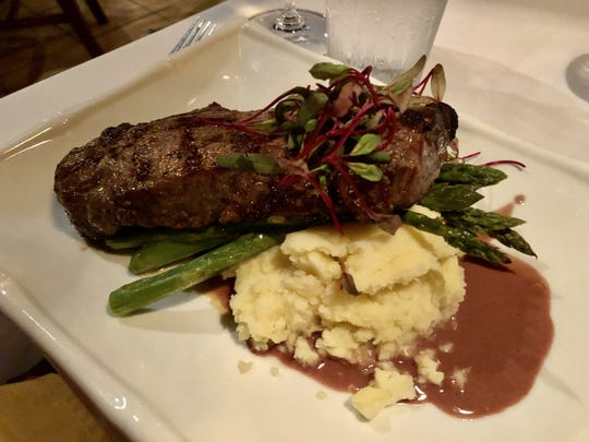 A grilled New York strip ($35) with mashed potatoes and a beurre rouge from A Table Apart in Bonita Springs.