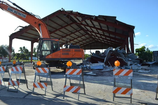 Honc Destruction takes down two Marine Max boat barns off McGregor Boulevard.