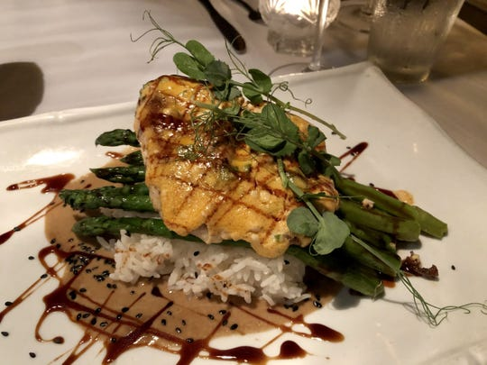 Triple tail ($36) seared in an Asian-inspired aioli and served atop asparagus and sticky rice from A Table Apart in Bonita Springs.