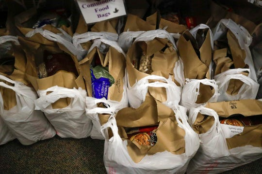 Bags of food are ready to be distributed to families and singles on Thursday at the Greater Green Bay Salvation Army in Green Bay.