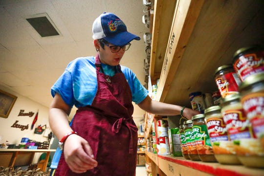 Volunteer Zeoi Baum organizes the pantry on Thursday, Oct. 17 at Salvation Army of Greater Green Bay. The pantry downstairs is where private and store donations are held and packaged as well as monthly government donations.