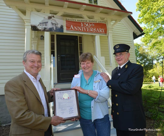 Rep. Joel Kitchens is shown with Ed and Sandy Miller at the celebration of the 150th anniversary of the Baileys Harbor Range Lights. Enough funds have been raised to complete restoration of the Upper Range Light to its 1900s appearance.