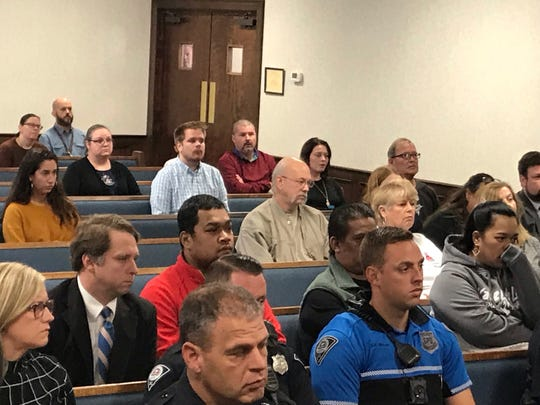 The family of 13-year-old Welfred Hallens sits in the second row during the court hearing of Norman Earl Gardner Jr. who struck Hallens in a road rage incident critically injuring him. Gardner, sitting in the fourth row, faces a charge of reckless driving.