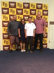 Caiyle a sophomore student was awarded $5,087 from FDMS Class of AD7 (James Tuquero Memorial Scholarship). He is pictured with his proud parents Ed and Celia Whitman and Jay Jones, senior vice president of Triple J Enterprises, Inc.