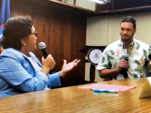 Gov. Lou Leon Guerrero, left, gestures as she addresses Del. Mike San Nicolas during an Oct. 17, 2019 meeting at Adelup.