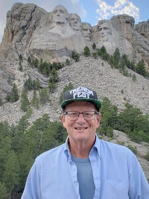 William Roth vacationing at Mount Rushmore, South Dakota, earlier this year. Roth, who served as principal of Father Duenas Memorial High School for nearly two decades,died Wednesday