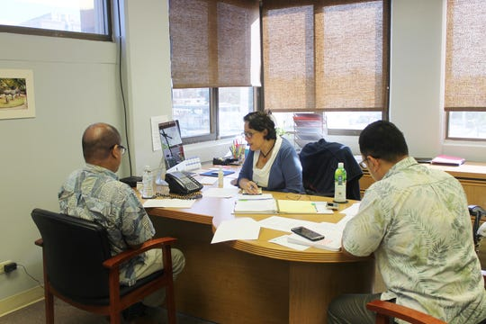 Melvin Tabilas of the Guam Economic Development Authority, Sen.Telo Taitague and Jason Tedtaotao of Taitague's office participate in a conference call with the Federal Communications Commission on Oct. 16.