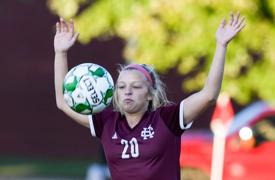 Henderson County's Morgan Green (20) tries to control a down field kick as the Henderson County Lady Colonels play the Hopkinsville Lady Tigers in the second round of the girls' regional soccer tournament at Hopkinsville's Stadium of Champions Wednesday evening, October 16, 2019.