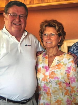 Former Kentucky basketball coach Joe B. Hall poses for a photo with his friend and partner in his new memoir, Henderson author Marianne Walker.