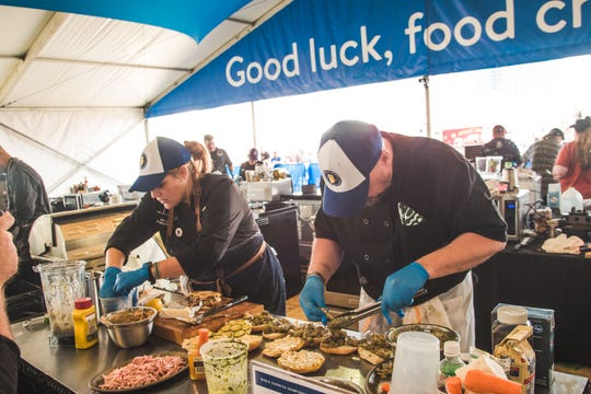 Indianapolis chefs Erin Gillum of Spoke & Steele and Luke Trinosky make bahn mi in the sandwich category at the 2019 World Food Championships semifinals this week in Dallas.
