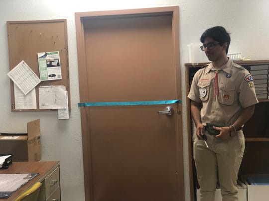 Mohid Tanveer, an Eagle Scout and University School of Jackson junior, started a food pantry at North Side High School for his Eagle Scout project, which was originally going to be a food drive. He prepares to cut the ribbon at the pantry's grand opening.