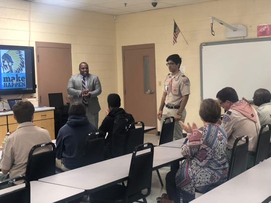 An audience applauds Mohid Tanveer, an Eagle Scout and University School of Jackson junior who started a food pantry at North Side High School for his Eagle Scout project. North Side High Principal Jason Bridgeman is pictured to the left.