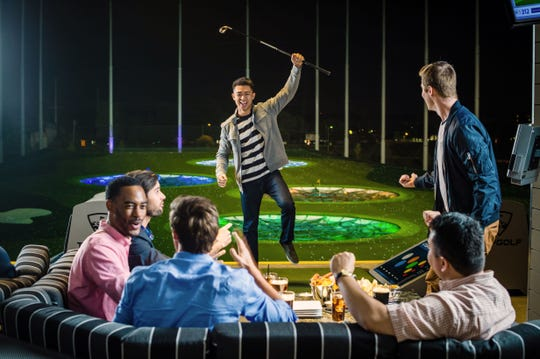 A stock image from Topgolf illustrates what the suites will look like, as well as the colorful targets on the driving range.