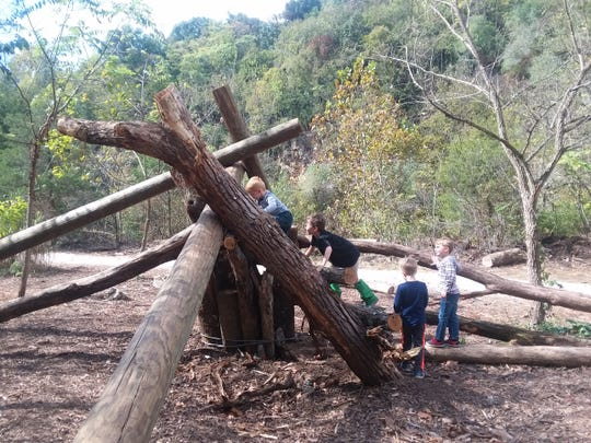"Ijams Nature Preschool students test out the new Primal Playground. ""The nature preschool teacher loves this because proprioception is so important in early childhood. We need to give them experiences that challenge their balance,"" said Amber Parker, executive director of Ijams Nature Center."
