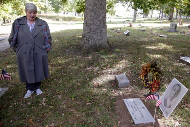 Diana Vice speaks next to a newly placed headstone is placed over Leonard William Inman's grave, Thursday, Oct. 17, 2019 at Spring Vale Cemetery in Lafayette. Inman, who was one of 18 African American soldiers from Tippecanoe County who served in World War I, was buried in an unmarked grave after his death in 1973.