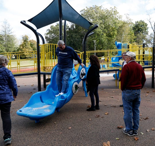 Craig Miller walks down a walking slide Thursday, Oct. 17, 2019, at Hunter Park in Lancaster. Miller, Joan Miller, left, Fran Tiburzio, third from left, Mike Tharp Jr., second from right, and Jim Edwards, right, were exploring the new all access playground at Hunter Park in Lancaster. The playground, which was built with more than $300,000 in donations from the Kiwanis Club of Lancaster, will open the public Oct. 29.