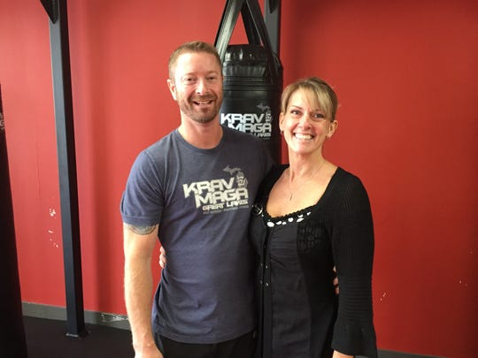 Husband and wife Mike and Dori Berean, of Brighton are raising funds for cancer research. Mike Berean attempted to break a Guinness World Record for chest-to-ground burpees. They are shown Thursday, Oct. 17, 2019.
