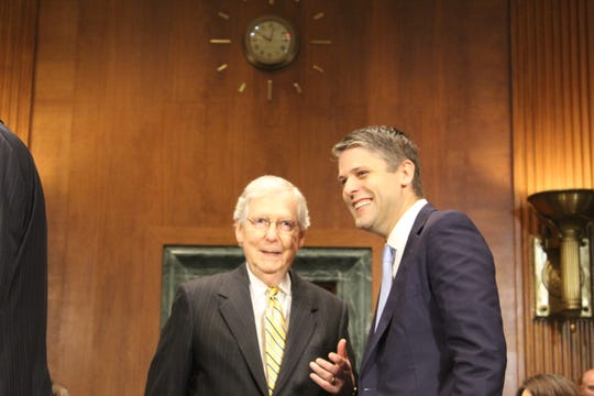 University of Louisville law professor Justin Walker, shown here with U.S. Sen. Mitch McConnell, was nominated by President Donald Trump to become a federal judge in Kentucky. A Senate committee advanced his nomination Thursday.