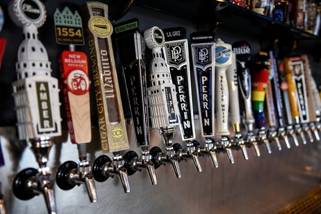 The beer taps that offer customers a wide selection are photographed at Henry's Place on Wednesday, Oct. 16, 2019, at the Meridian Towne Center in Okemos.