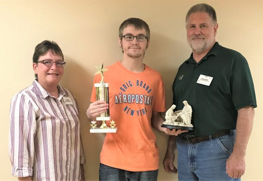 Brandon Rehme, center, in housekeeping at Felician Village in Manitowoc, was awarded the company's Service Excellence Star Award for the month of October. Also pictured are Lori Sharpe (left), housekeeping supervisor, and Michael Miller, director of environmental services.