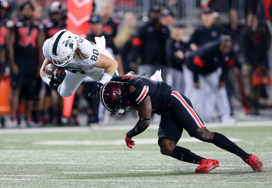 Ohio State safety Jordan Fuller tackles Michigan State tight end Matt Seybert in in the Buckeyes' 34-10 win two weeks ago.