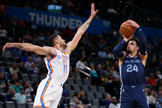 Memphis Grizzlies guard Dillon Brooks (24) shoots as Oklahoma City Thunder forward Abdel Nader (11) defends during the first half of an NBA preseason basketball game Wednesday, Oct. 16, 2019, in Oklahoma City. (AP Photo/Sue Ogrocki)