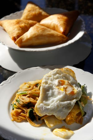 Food of the Karen people includes samosa, pastries filled with potato and onion, and noodles with egg and vegetables. The Karen will be represented at the next Tables Across Borders pop-up dinner series, starting in November.