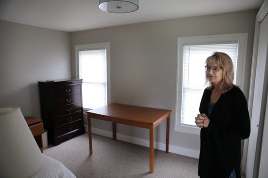 Kimberly Hill stands in a room of the sole sober-living recovery house in Iowa County, Wisconsin. She manages the facility, which currently houses three women recovering from addictions to opioids. It is funded by a grant that targets opioids, but cannot be used to treat addictions to other substances.