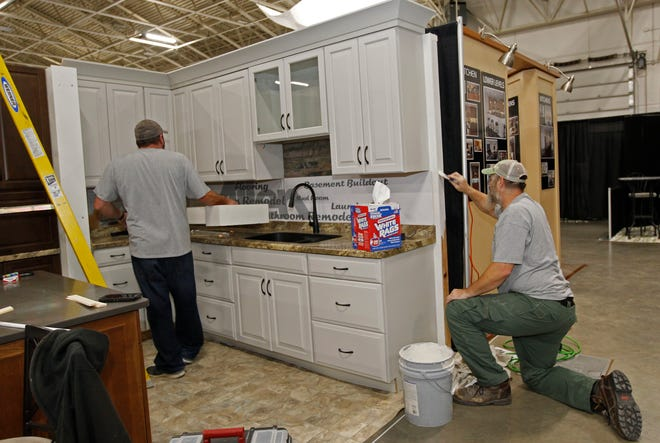 Ross Hecker, left, and Tony Sasso put finishing touches on a kitchen design by Allen Kitchen and Bath, which has locations in Brookfield and Madison. The exhibit is part of the annual NARI Milwaukee Home & Remodeling Show at the Wisconsin Exposition Center at State Fair Park. More than 100 NARI members will staff exhibits Friday through Sunday showcasing their products and services.