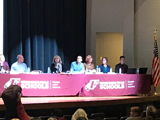 Menomonee Falls School Board president Faith VanderHorst speaks to the crowd at a special board meeting Oct. 16 regarding Menomonee Falls High School's mascot, the Indians.