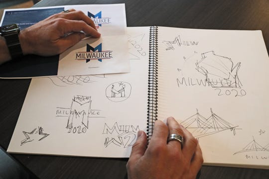 Jim Taugher, CEO, Creative Director of CI Design Inc. in Milwaukee, with his sketch book with ideas that went into designing the logo for the 2020 Democratic National Convention in Milwaukee.