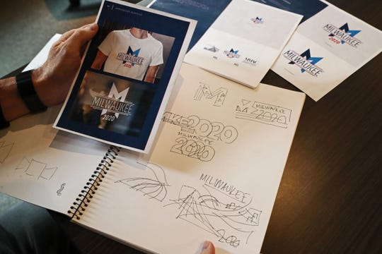 Jim Taugher, CEO and creative director of CI Design Inc. in Milwaukee, looks at his sketchbook with ideas that went into designing the logo for the 2020 Democratic National Convention.