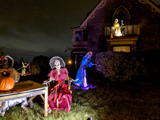 Day of the Dead skeletons decorate the yard at 3317 S Kinnickinnic Ave.