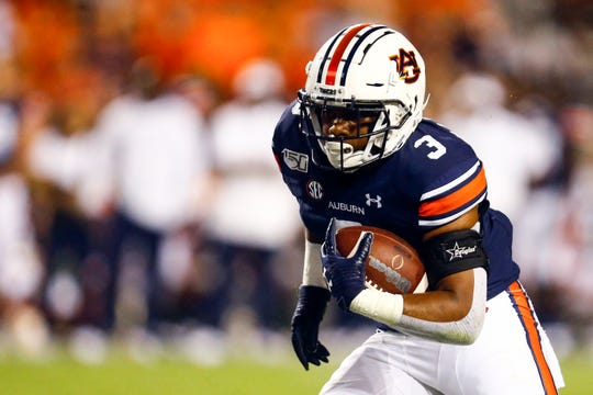 Auburn running back D.J. Williams (3) carries the ball against Mississippi State on Saturday, Sept. 28, 2019, in Auburn, Ala.
