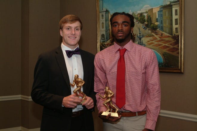 The Montgomery Quarterback Club honored last week's winners, Christian Ivey from Montgomery Catholic Preparatory  (left) and Tray Duncan from Stanhope Elmore at its October 15 meeting.