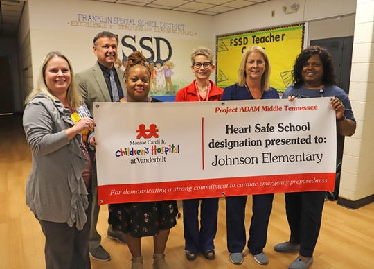Johnson Elementary School joins all eight schools in Franklin Special School District as a Heart Safe school. JES Assistant Principal Ashley McCoy (left) and Principal Tosha Robinson Baugh (far right) stand with FSSD Director of Schools David Snowden, Ph.D., Coordinated School Health Coordinator Lisa Chatman, Vanderbilt's Angel Carter, RN, and District Nurse Amy Fisher, RN.