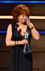 Reba McEntire, Artist of a Lifetime honoree, tears up as she thanks Thomas Rhett for praying for the family of Kane Brown's drummer, Kenny Dixon, who died in a car crash Sunday.
