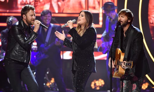 "Lady Antebellum performs Reba McEntire's ""Is There Life Out There"" at the 2019 CMT Artists of the Year at the Schermerhorn Symphony Center Wednesday, Oct. 16, 2019, in Nashville, Tenn."