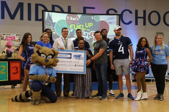 The Tennessee Titans presented Freedom Middle School staff with a $10,000 grant to promote health eating and physical exercise.