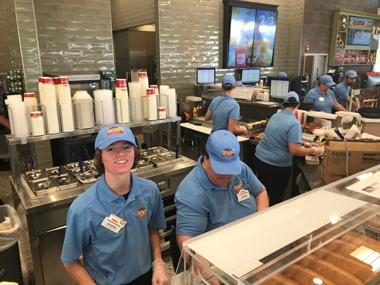 With Collier's second location, Wawa marks its 200th store opening in Florida with lots of fanfare, featuring the Lely High band, the Wawa mascot, temporary $2 a gallon gas prices and a human 200 formed by employees, students and customers.