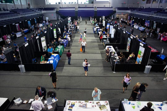 Dozens of companies seek workers to fill positions during a job fair at the Suncoast Credit Union Arena on Thursday, October 17, 2019, in Fort Myers