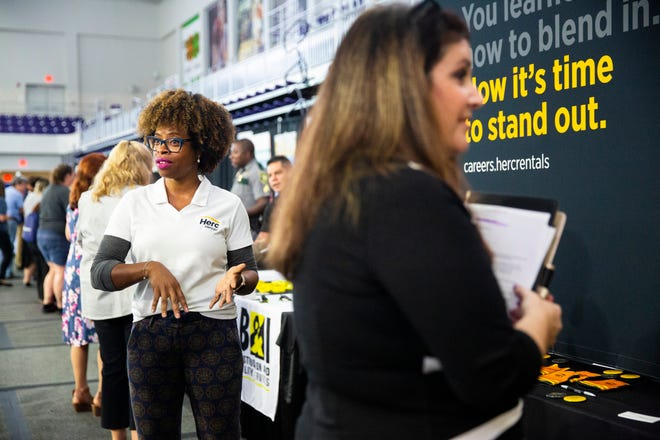 Treneice Collins, left, the campus recruiter for the Herc Rentals, talks to job seekers during a job fair at the Suncoast Credit Union Arena on Thursday, October 17, 2019, in Fort Myers.